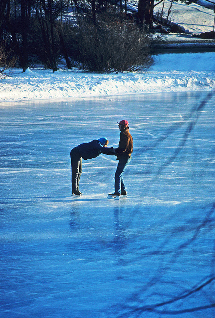 Ice Skating - Couple on an outdoor skating rink by Flickr user Wisconsin Department of Natural Resources